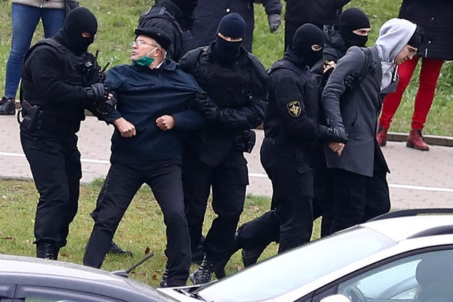 Belarusian riot police detain demonstrators during an opposition rally to protest the official presidential election results in Minsk, Belarus, on Sunday. Protests have rocked Belarus since the August election that official results say gave Lukashenko a sixth term in office but that opponents and some polls workers claim were manipulated.