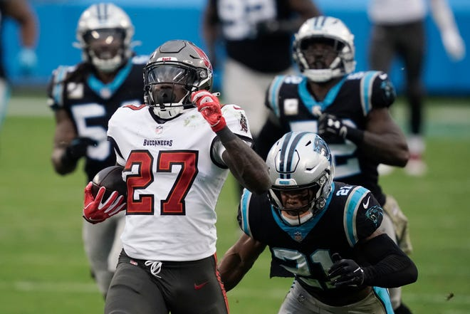 Tampa Bay Buccaneers running back Ronald Jones (27) runs for a 98-yard touchdown against the Carolina Panthers during the second half Sunday in Charlotte , N.C.