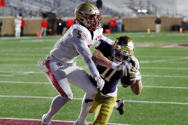 Notre Dame wide receiver Ben Skowronek (right) makes a touchdown reception against Boston College defensive back Deon Jones during the first half of BC's 45-31 loss to the No. 2 ranked Fighting Irish on Saturday, Nov. 14, 2020, in Boston. (AP Photo/Michael Dwyer)