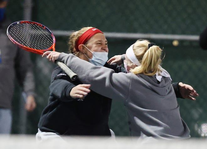 Tess Nunes, left, and Keeley Sheekey celebrate after Sheekey clinched the Rogers' 4-2 win over Classical in the Division III championship match Saturday evening at Slater Park in Pawtucket. [Newport Daily News / Louis Walker III]