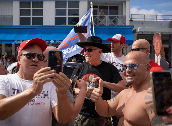 Roger Stone speaks to Trump supporters during a Stop the Steal rally, none wearing masks despite the coronavirus pandemic, in Delray Beach on Saturday.