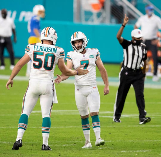 Miami Dolphins long snapper Blake Ferguson (50) congratulates kicker Jason Sanders (7) after a field goal near the end of the second quarter at Hard Rock Stadium in Miami Gardens, November 15, 2020.