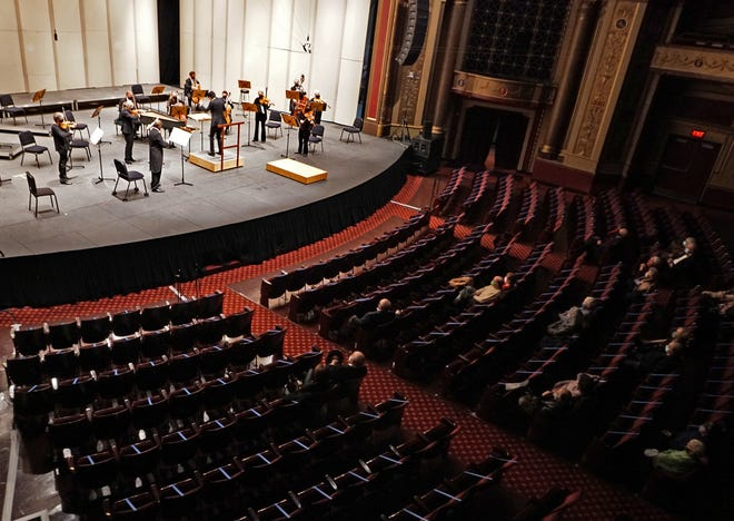 The Rhode Island Philharmonic plays in front of a socially distanced crowd Saturday at Veterans Memorial Auditorium.  [The Providence Journal / Sandor Bodo]