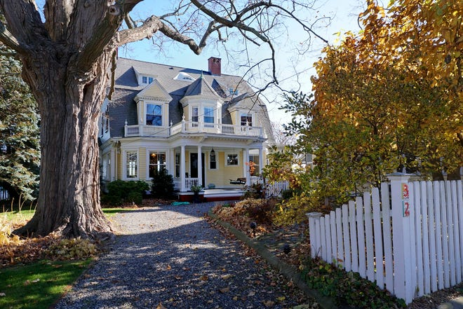 The House of the Week is a waterfront Victorian with panoramic views of Narragansett Bay with a private sandy beach and carriage house.