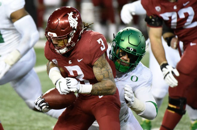 Nov 14, 2020; Pullman, Washington, USA; Washington State Cougars running back Deon McIntosh (3) is stopped for a loss by Oregon Ducks linebacker Noah Sewell (1) in the second half at Martin Stadium. Oregon won 43-29.