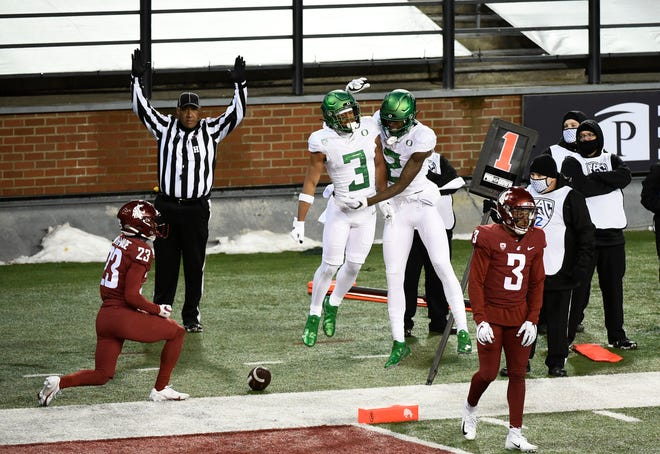 Nov 14, 2020; Pullman, Washington, USA; Oregon Ducks wide receiver Johnny Johnson III (3) and wide receiver Devon Williams (2) celebrate a touchdown against the Washington State Cougars in the second half at Martin Stadium. Oregon won 43-29.