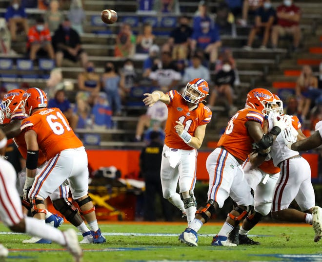 Florida Gators quarterback Kyle Trask (11) throws the ball during a football game Saturday against Arkansas at Ben Hill Griffin Stadium in Gainesville.