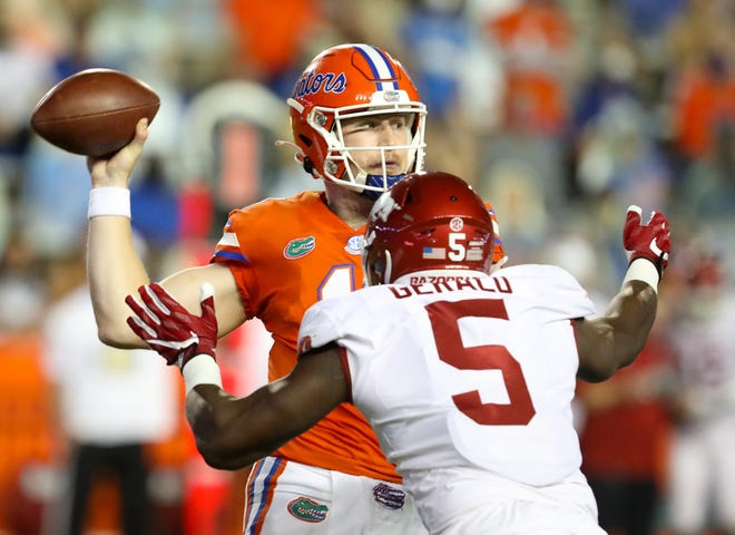 Florida quarterback Kyle Trask threw for 356 yards and six touchdowns, extending his school record for consecutive games with at least four TDs to six, and No. 5 Florida overwhelmed Arkansas 63-35 on Saturday night in The Swamp.