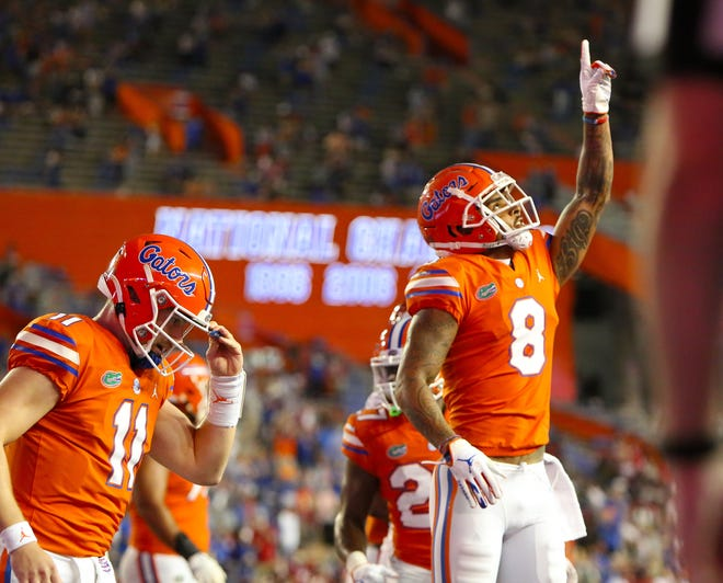 Florida Gators receiver Trevon Grimes (8) celebrates after catching a touchdown pass during a football game against Arkansas at Ben Hill Griffin Stadium.