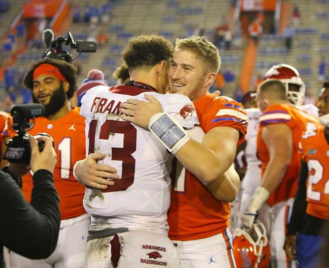 Former UF teams, Gators quarterback Kyle Trask hugs Arkansas quarterback Feleipe Franks (13) after the Gators' win over the Razorbacks on Saturday at Ben Hill Griffin Stadium.