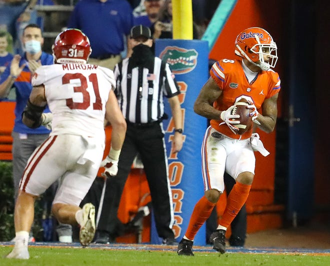 Florida receiver Trevon Grimes makes a touchdown catch, one of two he had Saturday, against Arkansas at Ben Hill Griffin Stadium.