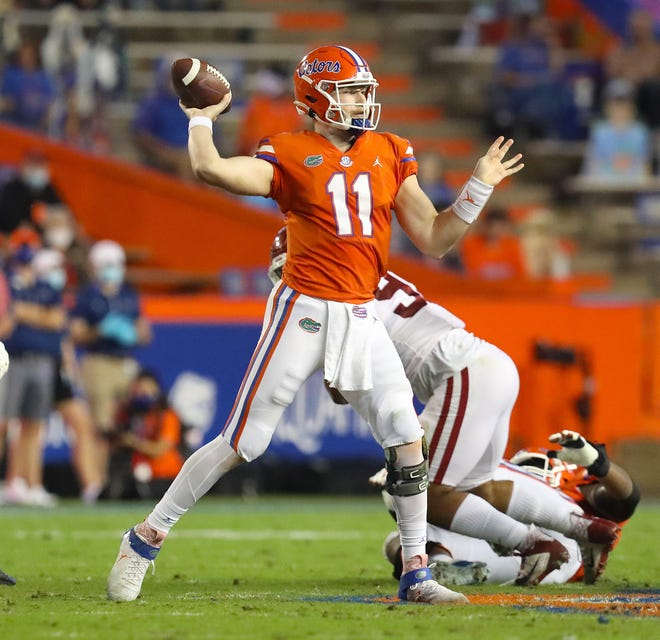 Florida Gators quarterback Kyle Trask (11) throws the ball during the game against Arkansas at Ben Hill Griffin Stadium in Gainesville on Saturday. The Gators won 63-35.