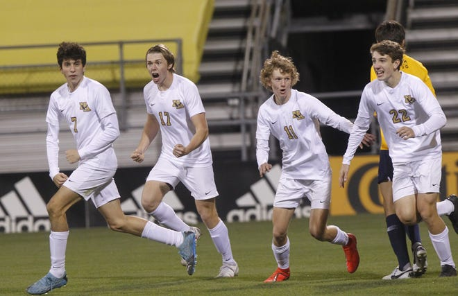 New Albany's Gabe Anthony (left), Ryan Blackburn, Calvin Criger and Jack Poulos celebrate after Henri Heyes scored in the Division I state final Nov. 14 at Mapfre Stadium. The goal cut the deficit to 2-1, but the Eagles would go on to lose to Cleveland St. Ignatius 4-1.