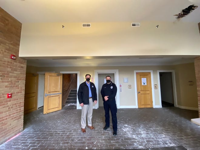 Westerville City Manager David Collinsworth and Westerville Division of Police Chief Charles Chandler stand in what eventually will be the lobby of the new Westerville police and court facility, 229 Huber Village Blvd.