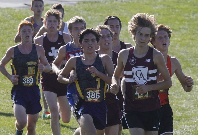 Academy's Luke Nester runs with a pack Nov. 7 during the Division II state meet at Fortress Obetz. Nester, one of seven seniors on the boys team, finished 16th overall to earn all-state honors.