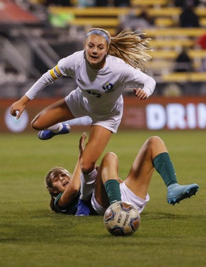 Olentangy senior forward Kylee Beinecke is tripped up by Strongsville's Peyton Felton during the state final.