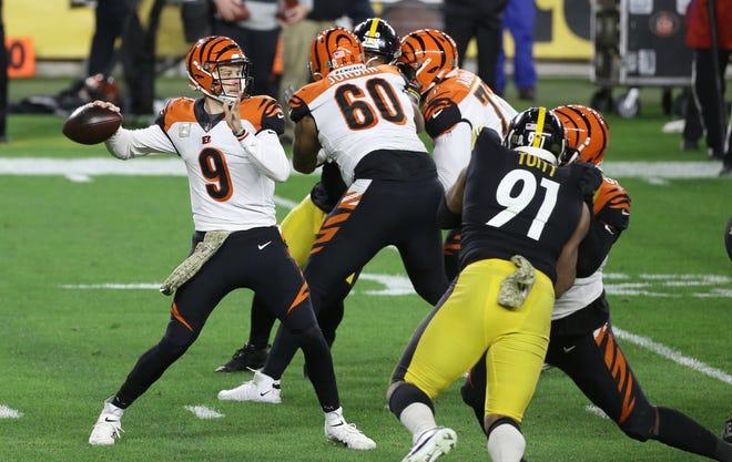 Nov 15, 2020; Pittsburgh, Pennsylvania, USA;  Cincinnati Bengals quarterback Joe Burrow (9) passes against the Pittsburgh Steelers during the second quarter at Heinz Field.