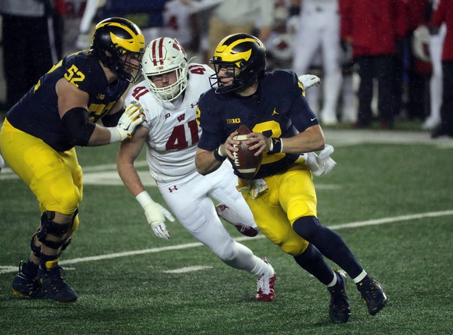 Michigan quarterback Cade McNamara looks to pass against Wisconsin during the second half of last week's game in Ann Arbor.