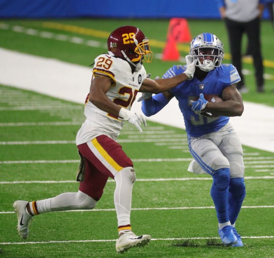 Lions runners D'Andre Swift ran away from Washington corner-back Kendall Fuller in the second half of the Lions' 30-27 victory on Sunday, November 15, 2020, at Ford Field.