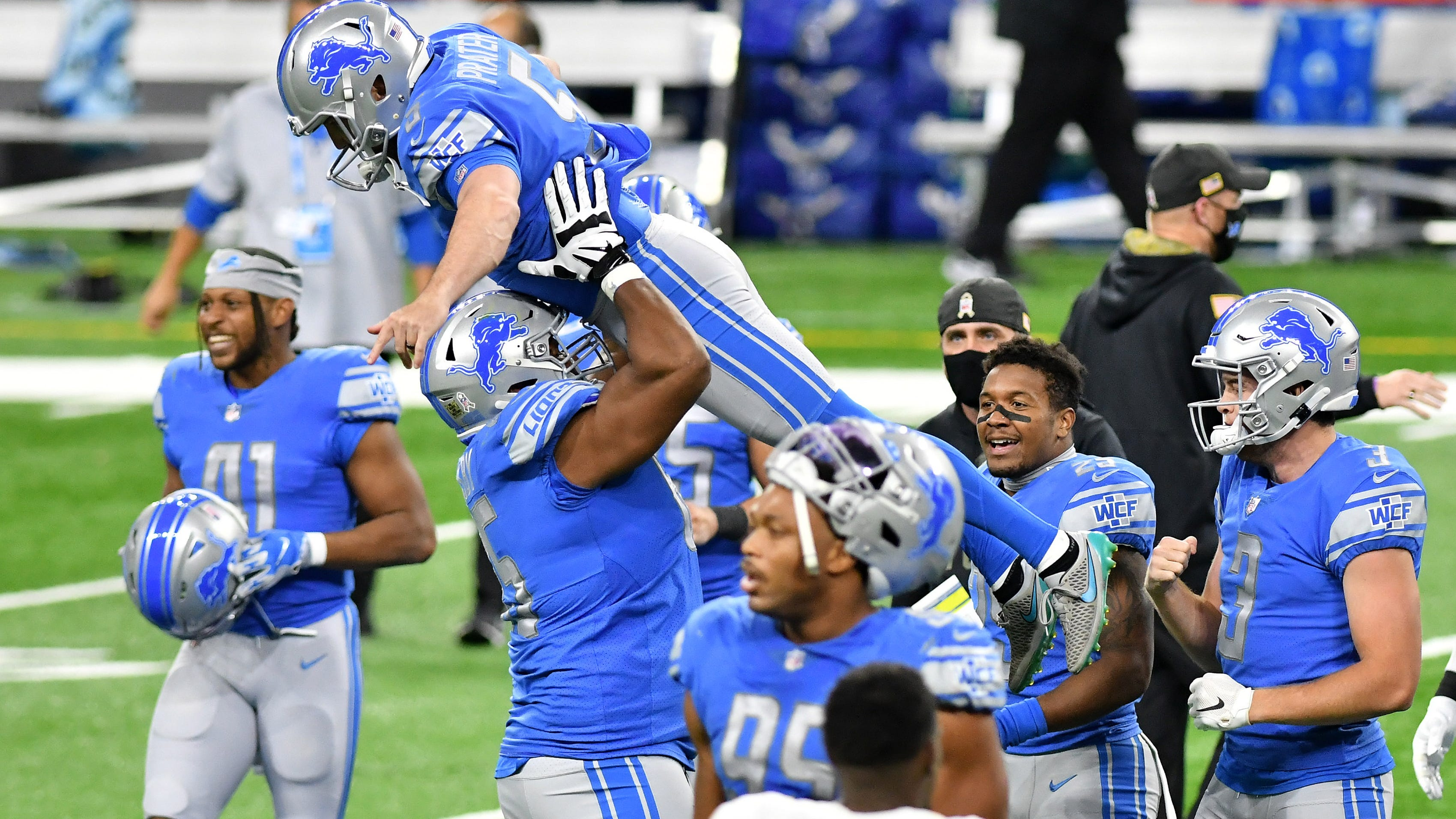 The Lions' Tyrell Crosby celebrates with kicker Matt Prater after the winning field goal as time expires.