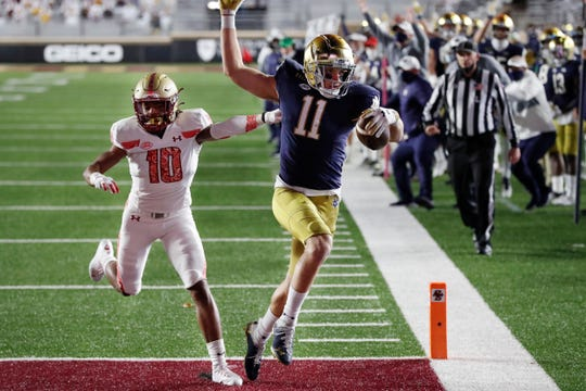 Notre Dame wide receiver Ben Skowronek (11) runs the ball in for a touchdown against Boston College defensive back Brandon Sebastian (10) during the first half.