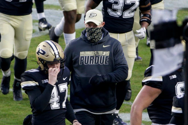 Purdue head coach Jeff Brohm walk across the field during the first quarter of a NCAA football game, Saturday, Nov. 14, 2020 at Ross-Ade Stadium in West Lafayette.