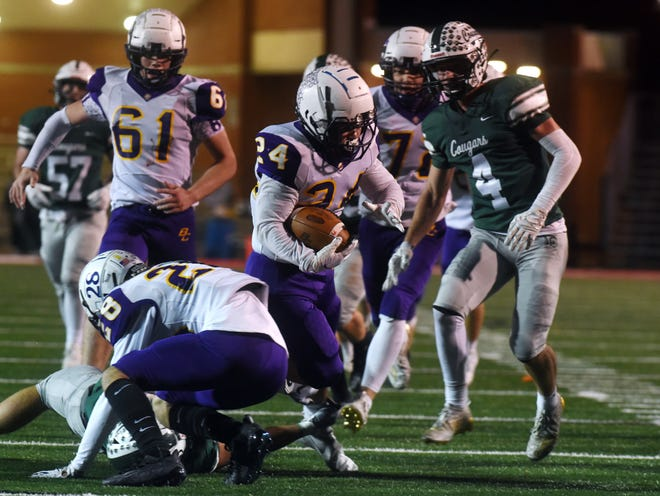 Evan Willet runs through traffic for Bloom-Carroll on Saturday night in a Division IV state semifinal against Mentor Lake Catholic at New Philadelphia's Woody Hayes Quaker Stadium.