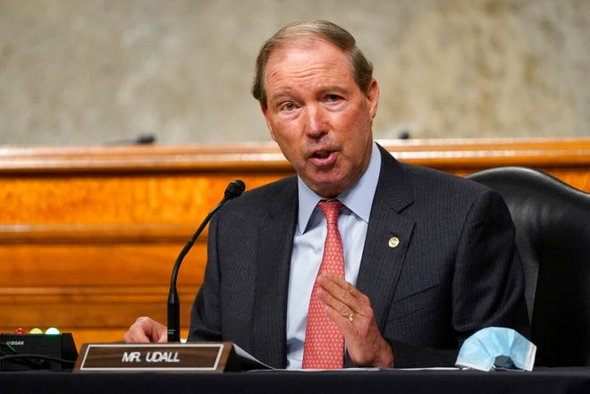 In this Sept. 24, 2020 file photo, Sen. Tom Udall, D-N.M., speaks during a Senate Foreign Relations Committee hearing on Capitol Hill in Washington.  Udall is retiring from the Senate, but has emerged as a leading contender to be Interior secretary under President-elect Joe Biden. If chosen, the Democrat would follow in the footsteps of his father, Stewart Udall, a former congressman who led Interior under two Democratic presidents in the 1960s.