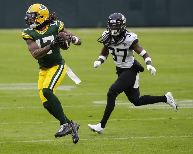 Green Bay Packers wide receiver Davante Adams (17) catches a pass against the Jacksonville Jaguars during the first quarter of a Week 10 NFL game on Sunday, November 15, 2020, at Lambeau Field in Green Bay, Wis.