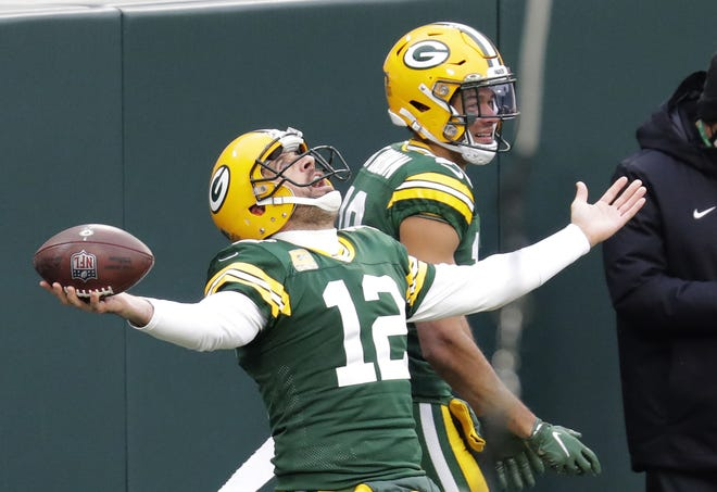 Green Bay Packers quarterback Aaron Rodgers (12) celebrates scoring a touchdown with wide receiver Equanimeous St. Brown (19) in the second quarter Sunday, November 15, 2020, at Lambeau Field in Green Bay, Wis.
