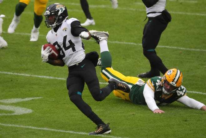 Jaguars wide receiver Keelan Cole (84) returns a punt 90 yards for a touchdown during the second quarter of their game against the Green Bay Packers at Lambeau Field on Sunday.