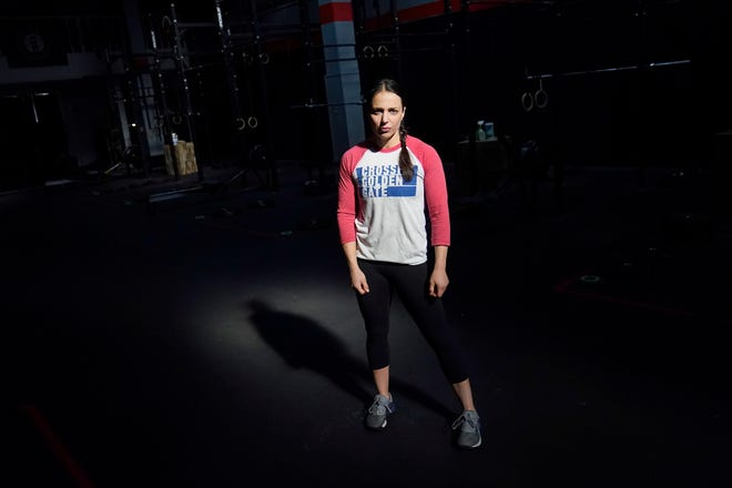 CrossFit Golden Gate owner Danielle Rabkin poses for photos at her gym in San Francisco, Thursday, Nov. 12, 2020. State and local health officials are blaming private gatherings for a surge in California coronavirus cases to levels unseen in months. That has business owners and some health experts scratching their heads over why the state's response has instead been to impose more restrictions on businesses like restaurants and gymnasiums in areas that have been backsliding.