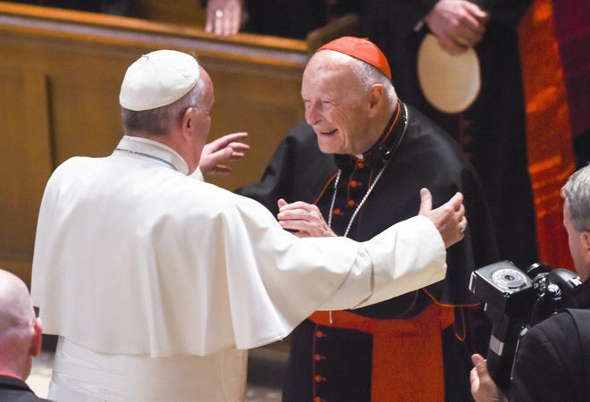 Cardinal Archbishop emeritus Theodore McCarrick, center, greets Pope Francis during Midday Prayer of the Divine with more than 300 U.S. Bishops at the Cathedral of St. Matthew the Apostle on Sept. 23, 2015 in Washington, D.C. (Jonathan Newton-Pool/Getty Images/TNS)