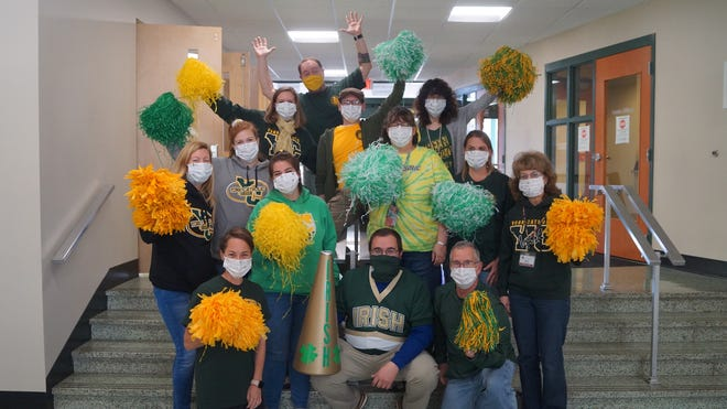 York Catholic High School is rallying behind a longtime faculty member who recently contracted COVID-19.
