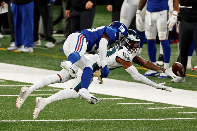 Philadelphia Eagles wide receiver Travis Fulgham (13) can't make a diving catch behind New York Giants cornerback Darnay Holmes (30) during an NFL football game, Sunday, Nov. 15, 2020, in East Rutherford, N.J. (AP Photo/Adam Hunger)