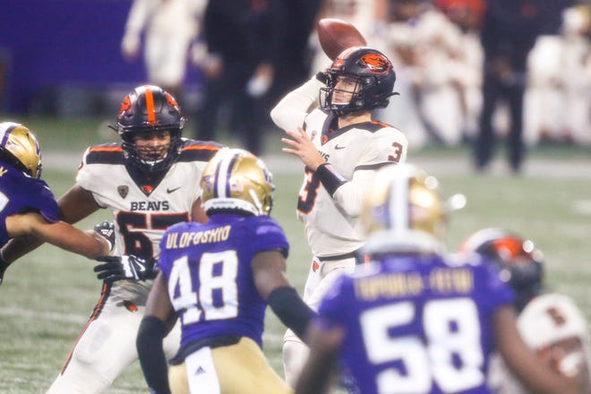 Oregon State quarterback Tristan Gebbia passes against Washington during the second quarter at Alaska Airlines Field at Husky Stadium on Saturday.