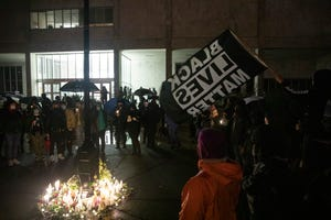 Community members observe a moment of silence to remember Herman Graham III during a candlelit vigil at the Marion County Courthouse in Salem, Oregon on Saturday, Nov. 14, 2020. Graham, 48, of Salem, was murdered on Oct. 26.