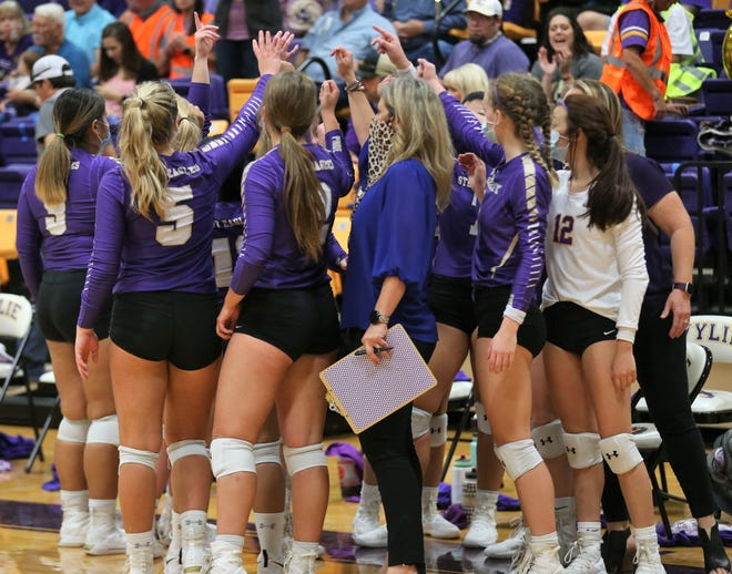 The Sterling City High School volleyball team talks strategy during a Class 1A regional final against Veribest at the Abilene Wylie gym on Saturday, Nov. 14, 2020.