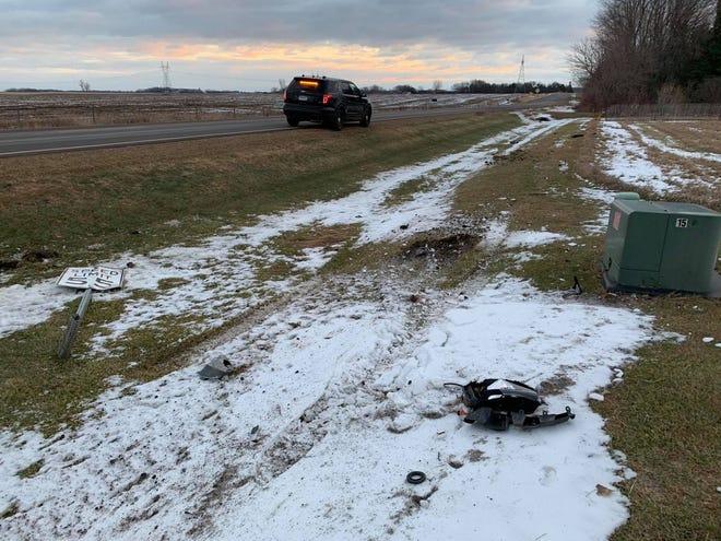 Road sign damage and vehicle debris