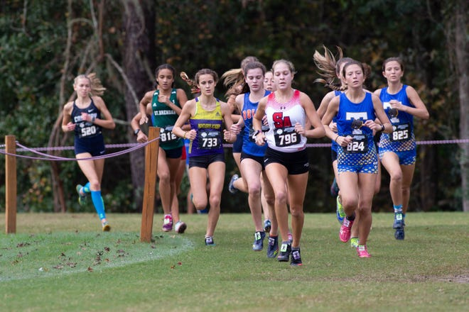 St. Andrew's Ellie Tymorek leads a pack of runners at the FHSAA Class 2A girls cross-country state championship meet in Tallahassee on Sunday.