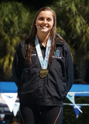 Jensen Beach junior Blair Stoneburg won the 200 and 500 freestyle and added another gold medal on the Falcons' 400 freestyle relay team at 2A FHSAA Swimming and Diving championships on Saturday, Nov. 14, 2020 at the Sailfish Splash Waterpark and Aquatics Center in Stuart to give her six career golds in her high school career.