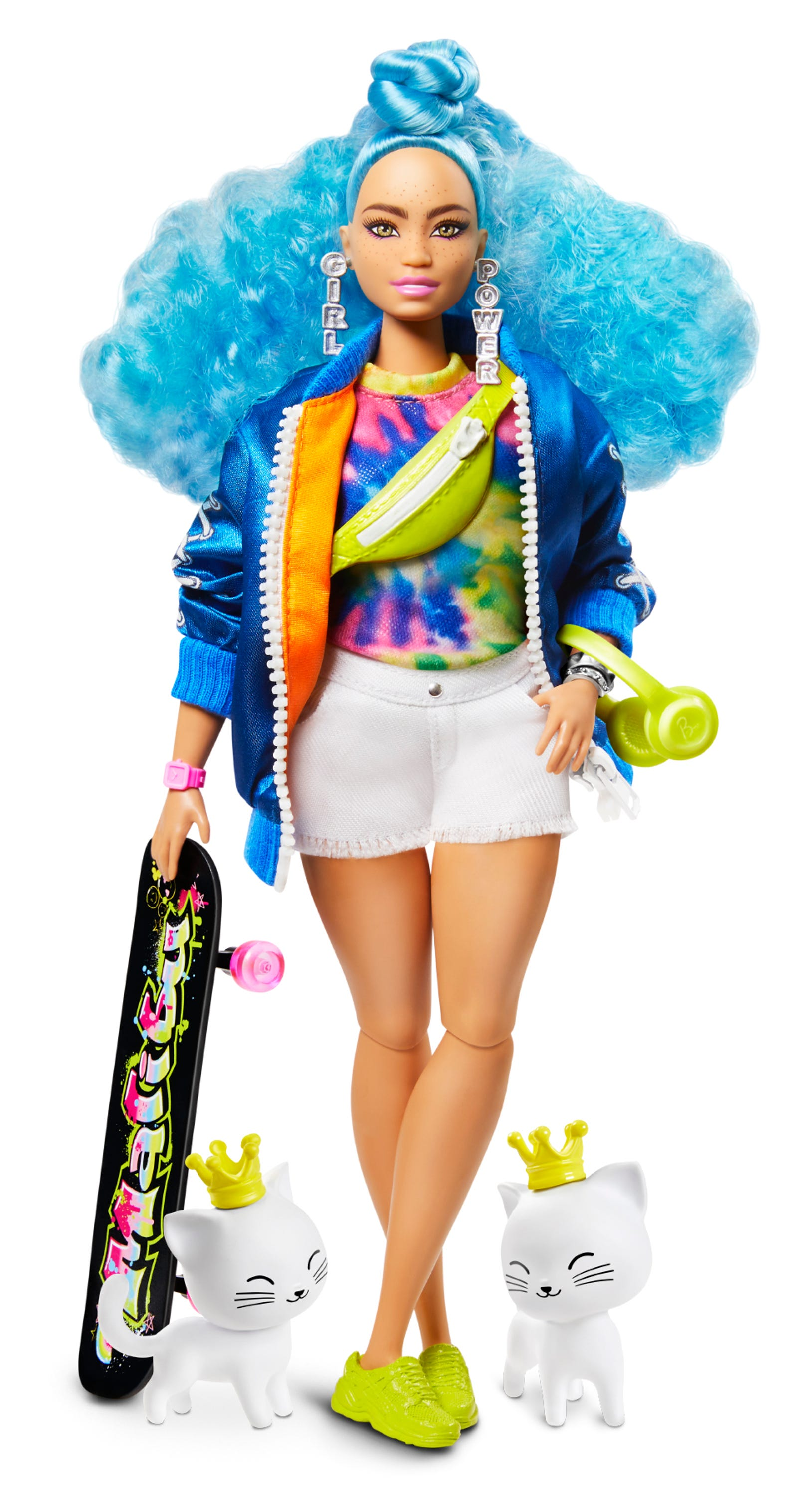 Mattel describes this Barbie Extra doll with bright blue hair as curvy. She wears a tie-dye shirt with a sateen bomber jacket, white denim shorts and neon sneakers. Her pet twin kittens wear tiaras.