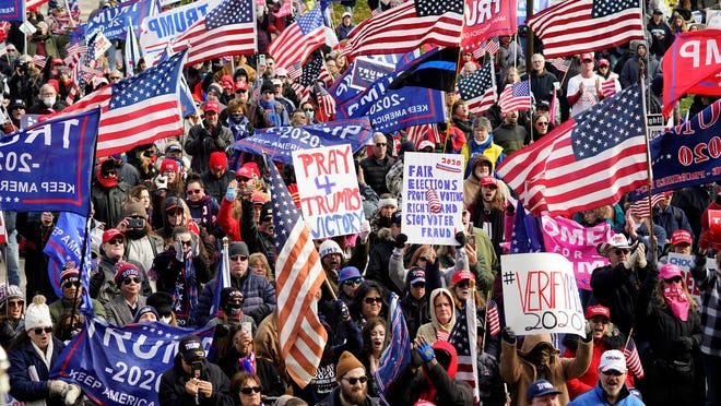 President Trump supporters rally at the Capitol building in Lansing, Mich., Saturday, Nov. 14, 2020.