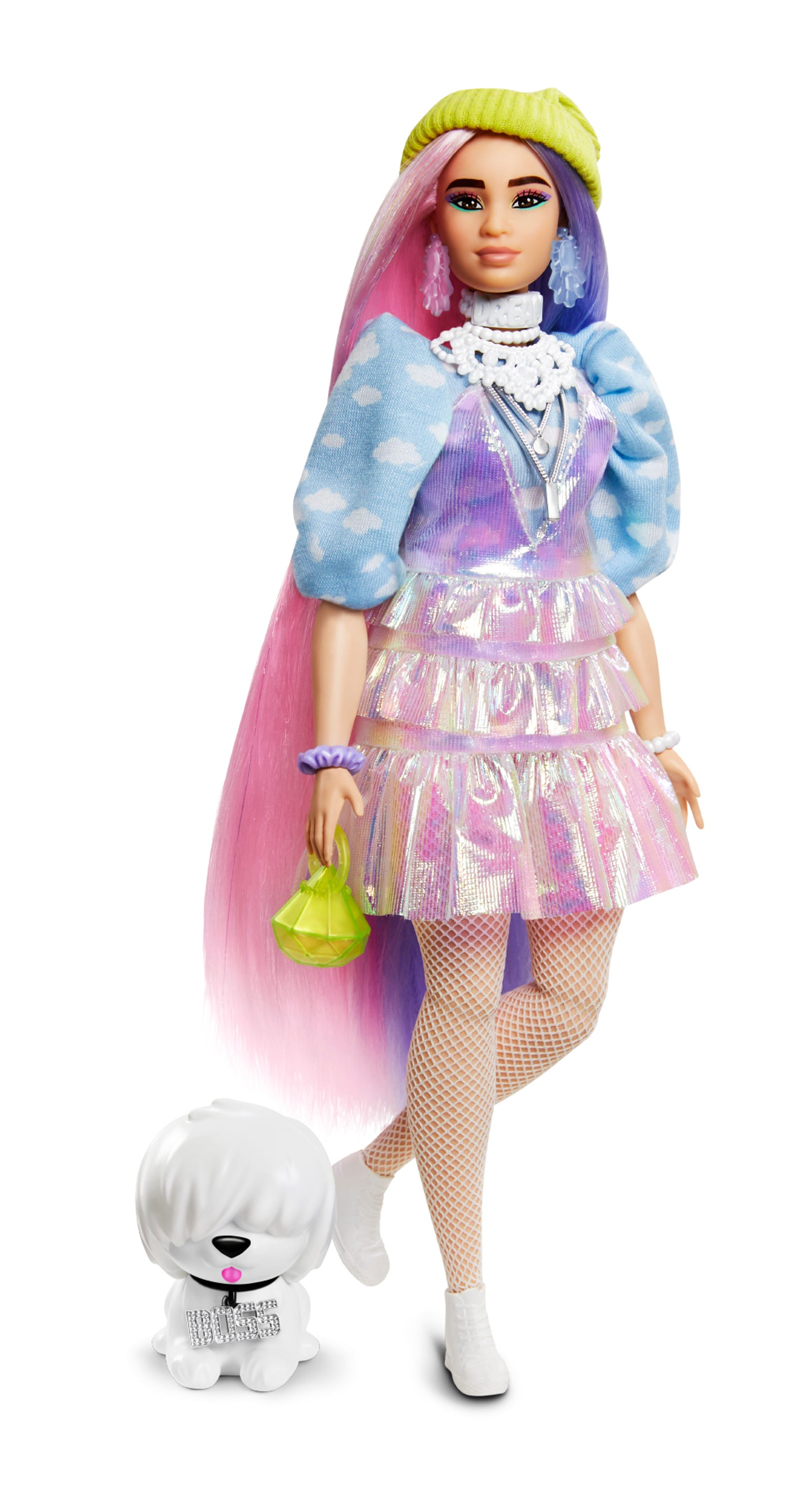 """Described as curvy, this Barbie Extra doll has 8.5 inches of long and shimmery, two-tone pink and purple fantasy hair. She wears an iridescent ruffle dress over a cloud print shirt, fish net tights and sneakers and her pet dog wears a jeweled """"boss"""" collar."""
