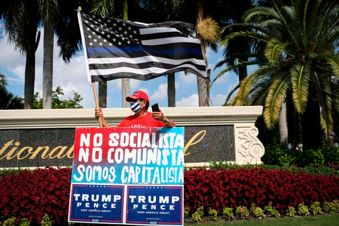 "Supporters of President Donald Trump rally outside the ""Latinos for Trump Roundtable"" event in Doral, in September. In Florida, Republicans succeeded in casting Biden as a ""trojan horse for socialism,"" increasing turnout in areas that went for President Trump, a key in winning him the state."
