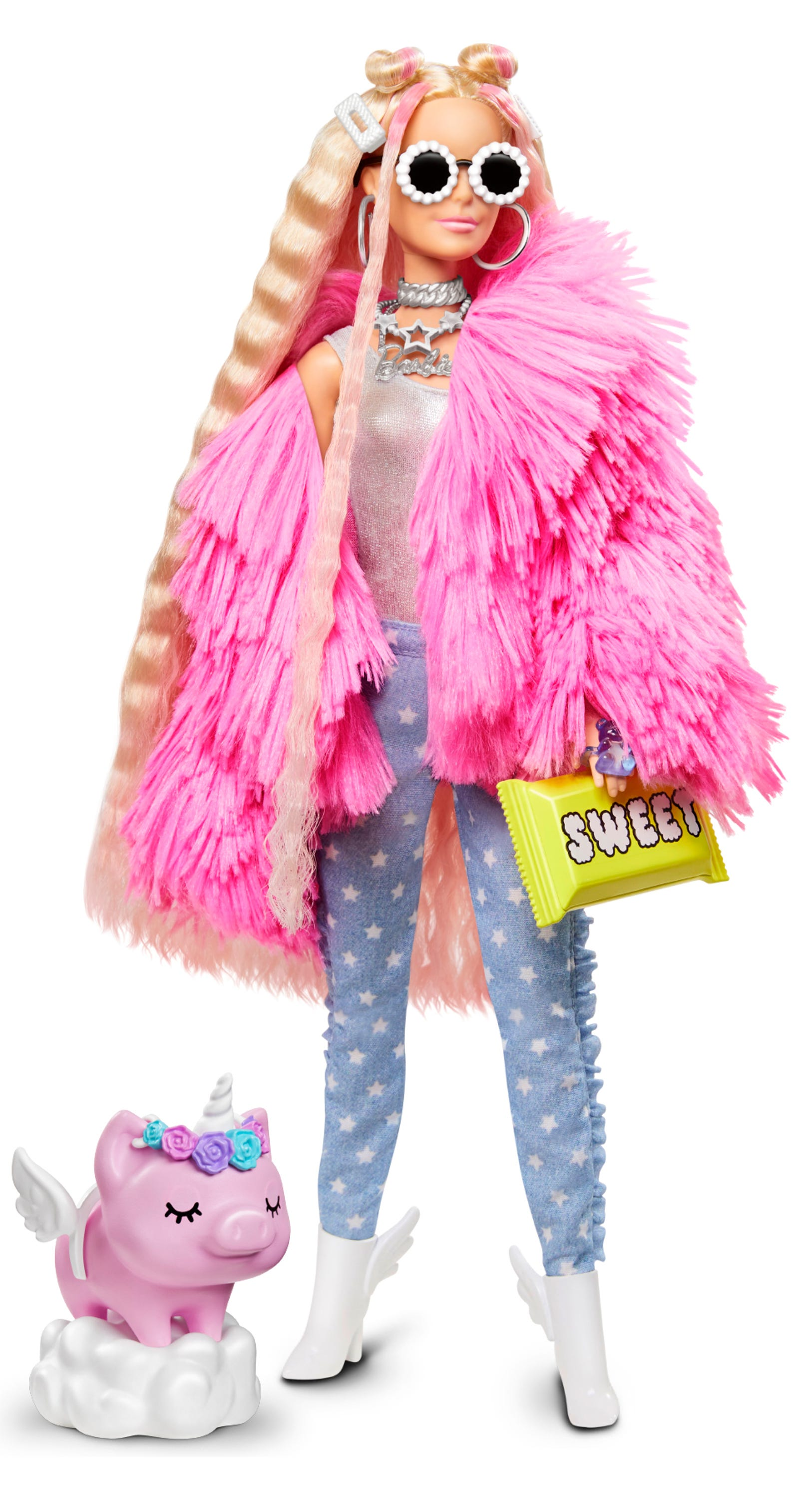This Barbie Extra doll has blonde hair with pink streaks and wears a fluffy pink jacket with jeans and winged boots. Her pet pig comes with a unicorn flower crown headband and removable unicorn wings.