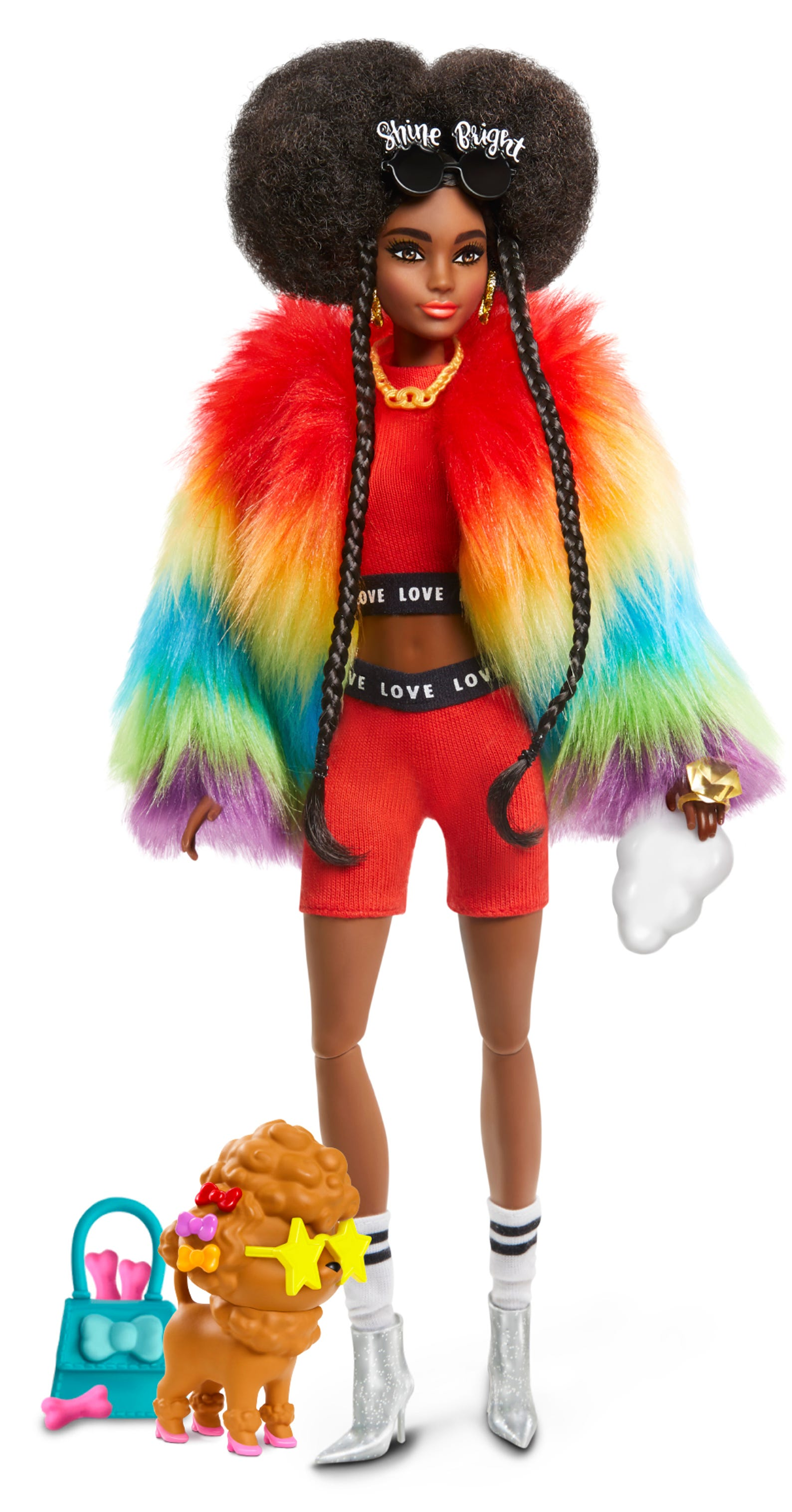 With Afro puffs and braided hair details, this Barbie wears a rainbow fur coat with a matching athleisure red top and shorts set, glittered boots and socks. Her pet poodle wears puppy heels and has a puppy purse with treats.