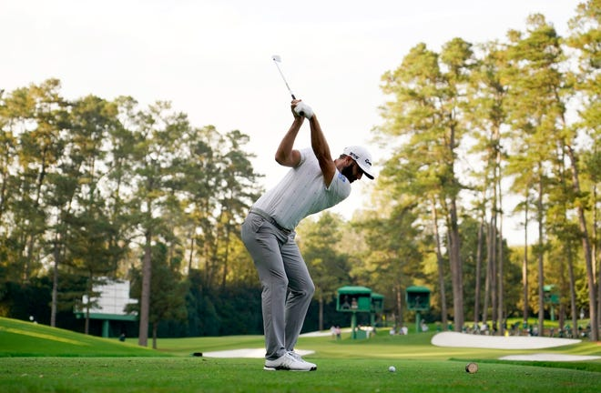 Dustin Johnson hits his tee shot at the Augusta National Golf Club's 16th hole during Saturday's third round at the Masters.