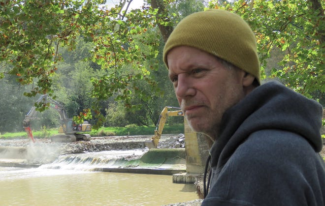 Rick Smirh watches the beginning of the demolition of Six Mile Dam in October.