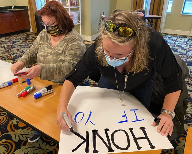 Nurses from St. Mary Medical Center in Middletown prepare signs on Sunday  for a strike called for Tuesday morning.